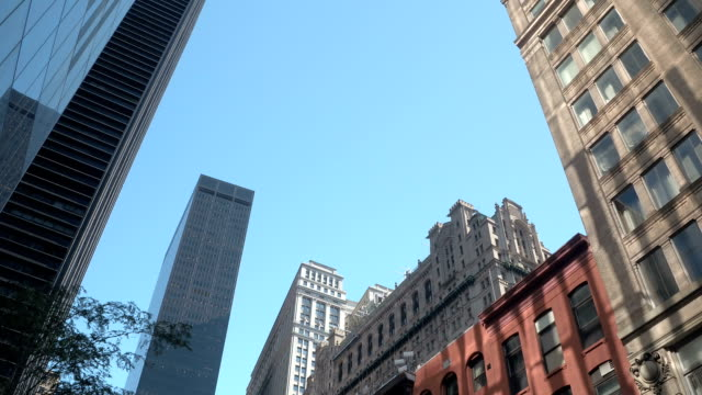 LOW ANGLE VIEW: Passing by stunning skyscrapers, historic buildings and condos video