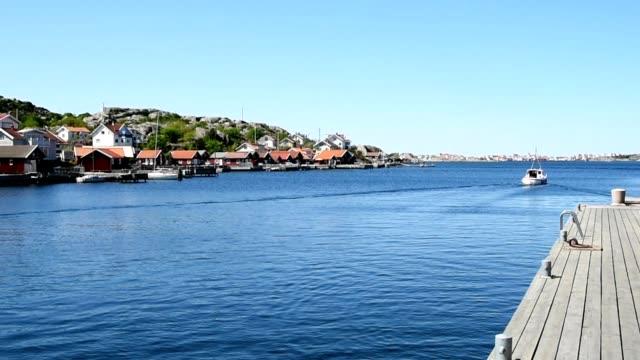 vídeos de stock e filmes b-roll de passing fishing boat - arquipélago