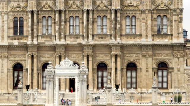 passing in front of dolmabahce palace, served as the main administrative center of the ottoman empire from 1856 to 1887 and 1909 to 1922. - neoclassical architecture stock videos & royalty-free footage