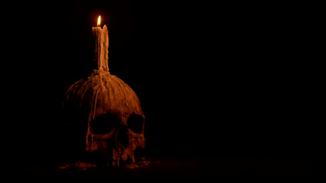Passing Old Skull With Melted Candle Tracking shot moving slowly past an old skull with candle on it count dracula stock videos & royalty-free footage