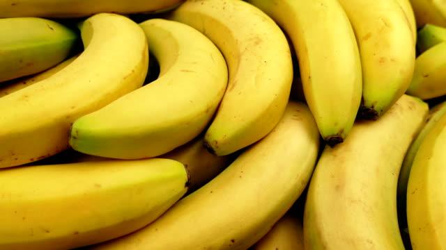 Passing Ripe Yellow Bananas