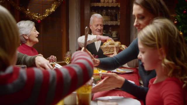 Passing the bread buns at the festive Christmas table video
