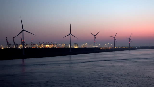 Passing the Rotterdam harbour after sunset - Netherlands video