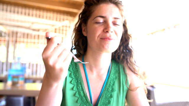 Passionate gourmand Beautiful young woman enjoying her lunch at the open air restaurant. eyes closed videos stock videos & royalty-free footage