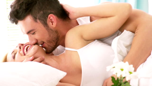 Passionate man and woman in bed
