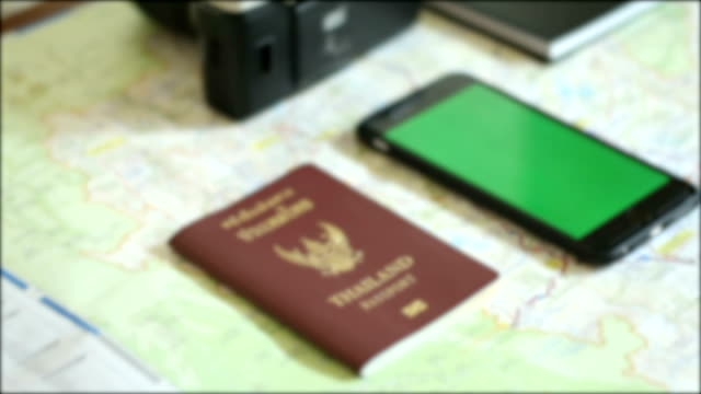 passport and smartphone on map for travel video