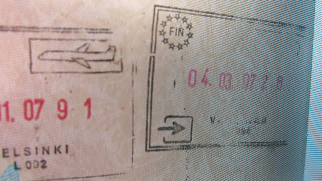 passport stamp, helsinki, finland - passports and visas stock videos and b-roll footage