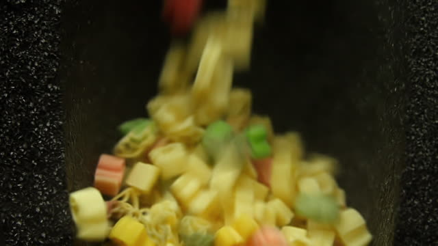 Pasta drop into a black box in slow motion. Pasta drop into a black box in slow motion. uncooked pasta stock videos & royalty-free footage