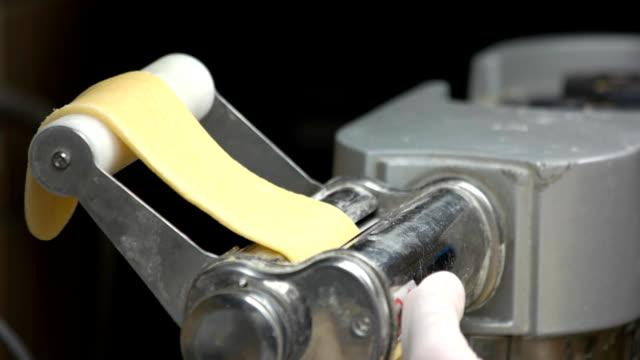 Pasta maker close up. Pasta maker close up. Thin raw dough. ravioli stock videos & royalty-free footage