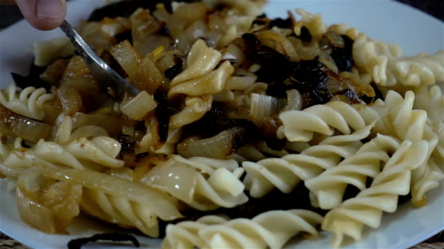 pasta meal on a plate in slow motion. - articoli casalinghi video stock e b–roll