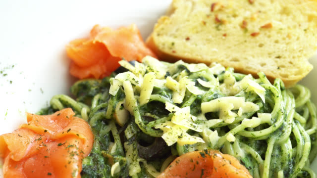 Pasta pesto salmon Pasta pesto salmon pesto sauce stock videos & royalty-free footage