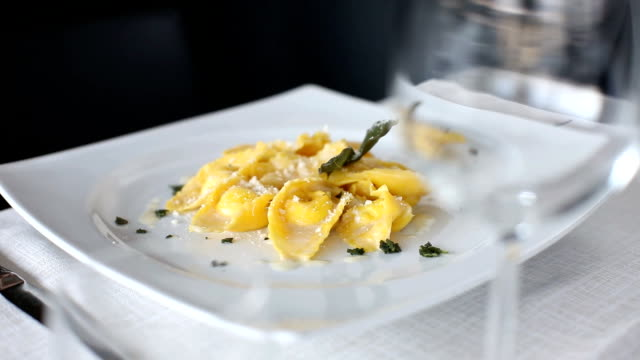 Pasta plate Ravioli with butter and sage. 360 rotation food ravioli stock videos & royalty-free footage