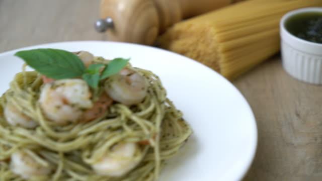 pasta spaghetti with pesto green and shrimp pasta spaghetti with pesto green and shrimp pesto sauce stock videos & royalty-free footage