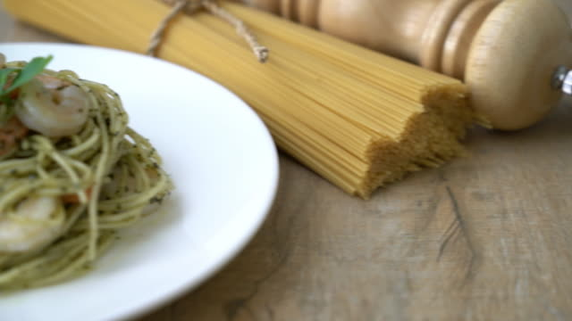 pasta spaghetti with pesto green and shrimps - italian food stock videos & royalty-free footage