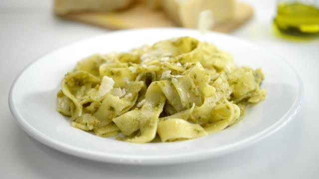 Pasta with pesto and parmesan Pasta with pesto sauce and Parmesan cheese. Nikon D800. pesto sauce stock videos & royalty-free footage