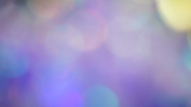 Pastel neon colors defocused lights bokeh. Abstract holographic foil background. Glitter surface Holographic background. The surface of the crystals and prism. Sparkling highlights and rainbow colors prism stock videos & royalty-free footage