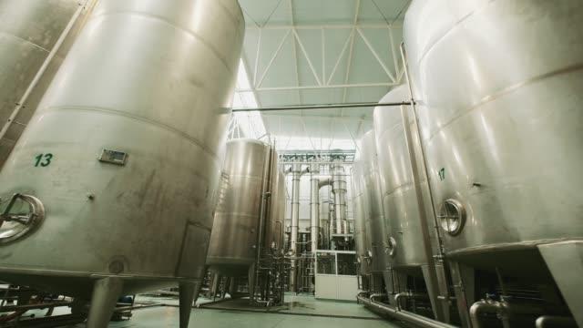 pasteurization equipment. juice factory. - нержавеющая сталь стоковые видео и кадры b-roll