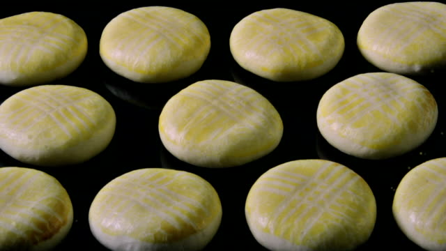 Pastry Bun baking in oven - Time Lapse #003 Zooming into a group of savoury Turkish