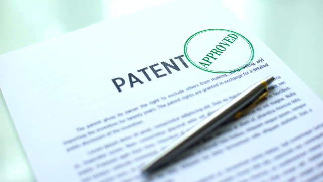 Patent document approved, hand stamping seal on official paper, copyright law