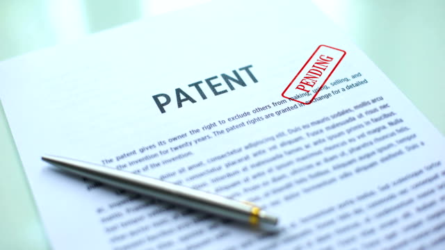 Patent document pending, hand stamping seal on official paper, copyright law