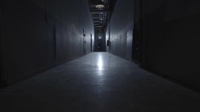 path inside prison camera walking in the path inside prison with cells escaping stock videos & royalty-free footage