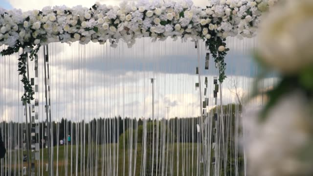 path to wedding registration arch with floral decoration video