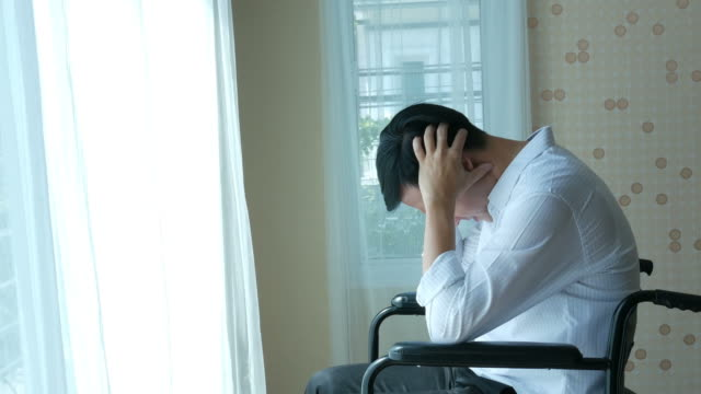 patient businessman sit on wheelchair , feel depressed patient businessman sit on wheelchair , feel depressed depression land feature stock videos & royalty-free footage