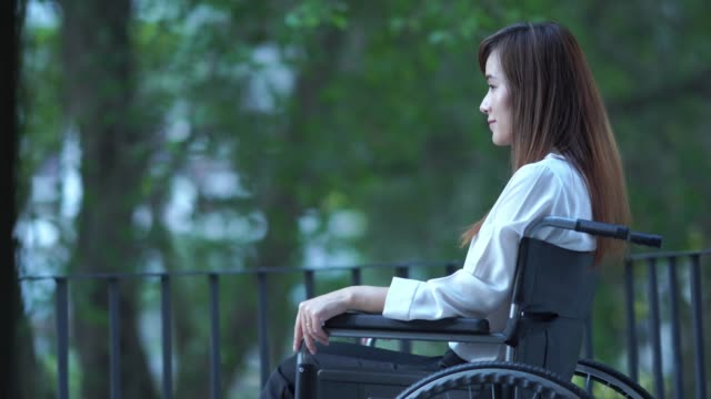patient businesswoman sit on wheelchair , feel depressed