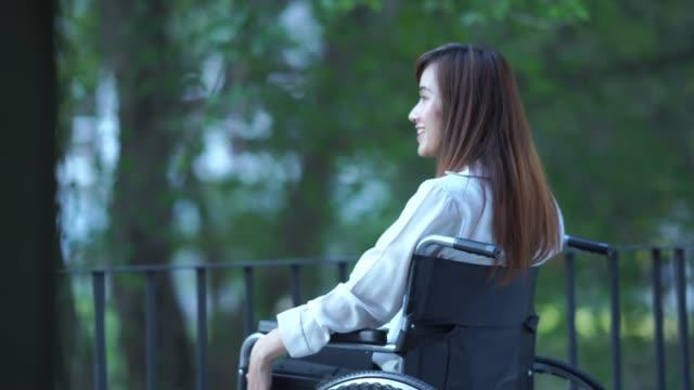 patient businesswoman sit on wheelchair , , freshness , positive emotion