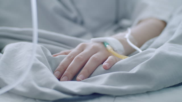 Patient hand on the bed Patient hand on the bed cancer patient stock videos & royalty-free footage