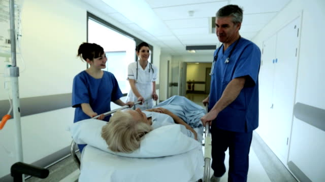 Patient Hospital Bed Moved by Medical Staff Slow Motion video