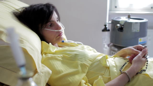 patient in hospital prays god with rosary  - lung cancer - depression video
