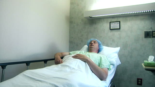 Patient In Hospital Patient waiting in hospital. hospital gurney stock videos & royalty-free footage
