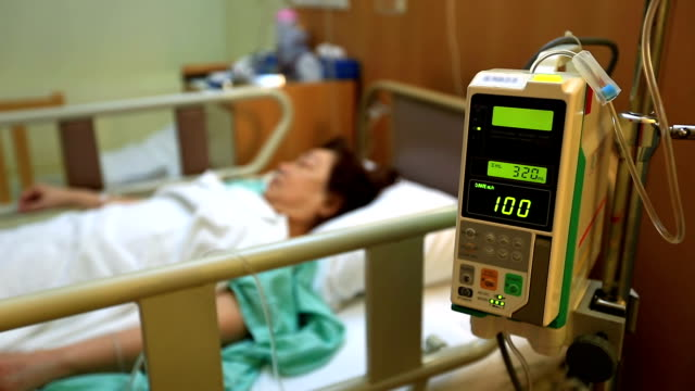 Patient in Hospital with Saline Solution Volumetric Infusion Pump video