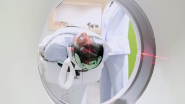 Patient is scanned by MRI, CT scanner. Magnetic resonance examination. Patient is scanned by MRI, CT scanner. Magnetic resonance examination. scientific imaging technique stock videos & royalty-free footage