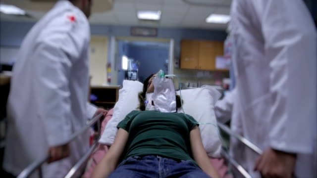 Patient on gurney at hospital Hospital patient being taken to the operating room for doctors stretcher stock videos & royalty-free footage