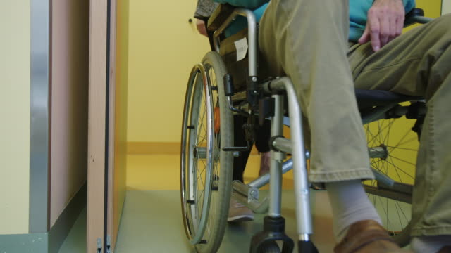 vídeos de stock e filmes b-roll de patient sitting on wheelchair at hospital - pessoas com deficiência