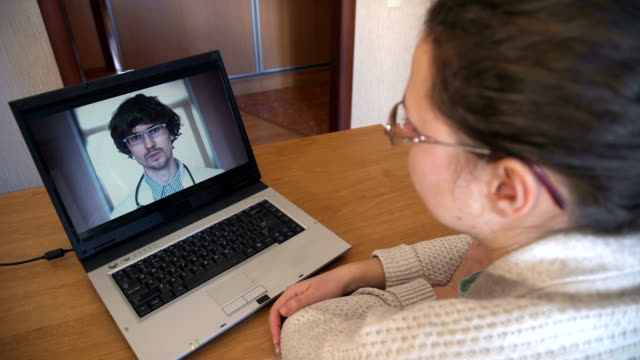 Patient video chatting with doctor video