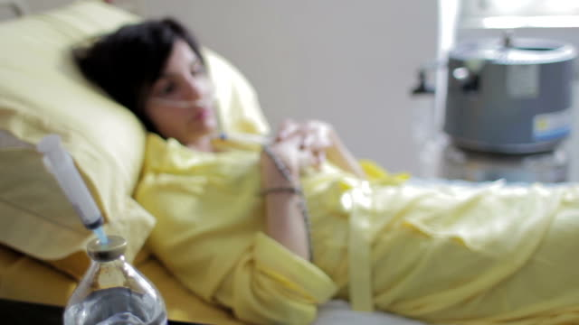 patient with cancer in hospital - sad and depressed woman with lung cancer video
