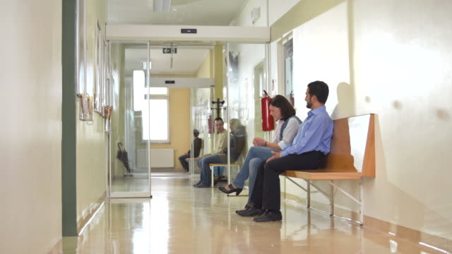 HD: Patients Waiting In Clinic Corridor video