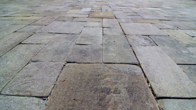 patio paving slab dolly shot - concrete architecture stock videos & royalty-free footage