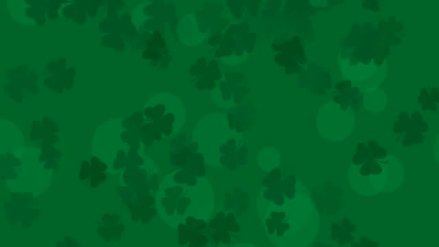 Patrick Day background with falling shamrock leaf pattern. For festive pub party. 3d render, loop 4k St. Patrick's Day green leaves background. Patrick Day backdrop with falling shamrock leaf pattern. For festive pub party. 3d render, loop 4k shamrock stock videos & royalty-free footage