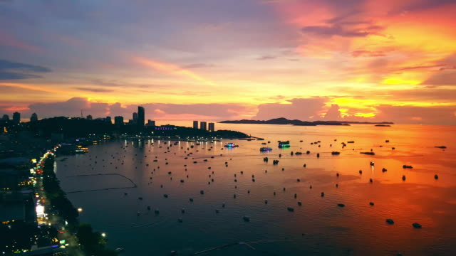 Pattaya city bay view with golden sunset High angle view of Pattaya city, sunset on the sea. pattaya stock videos & royalty-free footage