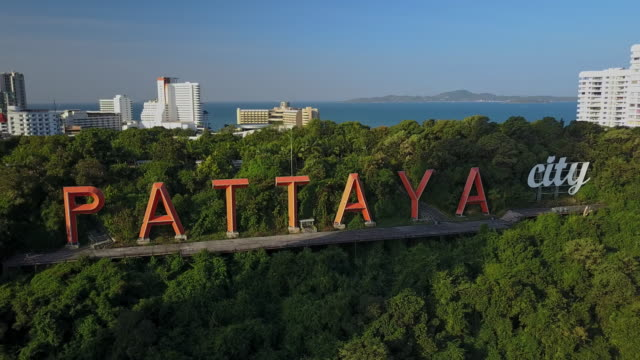 Pattaya City sign famous landmark Pattaya City sign on the hill from aerial view, Chonburi, Thailand pattaya stock videos & royalty-free footage