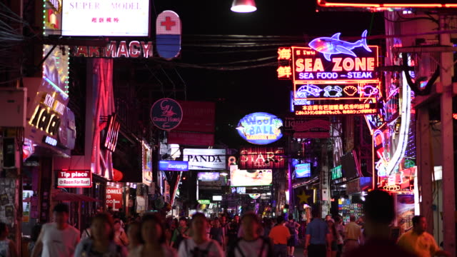 Pattaya Walking Street, the night city that never sleeps, Number one tourist destination At night in Pattaya This walking street is a tourist attraction that is well known to tourists. On the road is full of tourists from all over the country, both Thai and foreign, lined with entertainment, pubs, bars, shows, famous restaurants and shops that are decorated with light-colored signs. Can be said to be a meeting place to meet popular people in the night of tourists In addition to eating, drinking, talking, there are also lots of shows. Not only in entertainment venues that have shows only If you enjoy walking At some point, there will be an actor opening the hat. That shows amazing talents, such as magic shows, actors dressed in imitation of famous characters in Hollywood movies, etc. pattaya stock videos & royalty-free footage