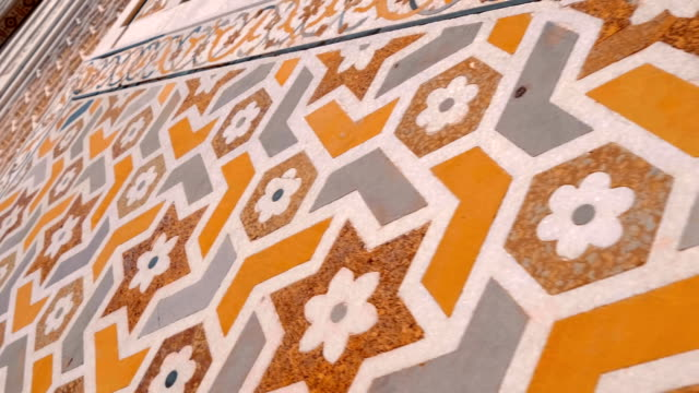 Pattern and ornate walls and floor inside building of  the historical Agra Fort Pattern and ornate walls and floor inside building of  the historical Red Fort of Agra, India. Shot in motion palace stock videos & royalty-free footage
