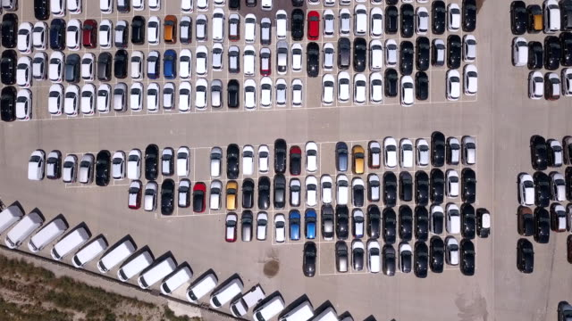 Pattern of new cars in a parking lot. Drone view