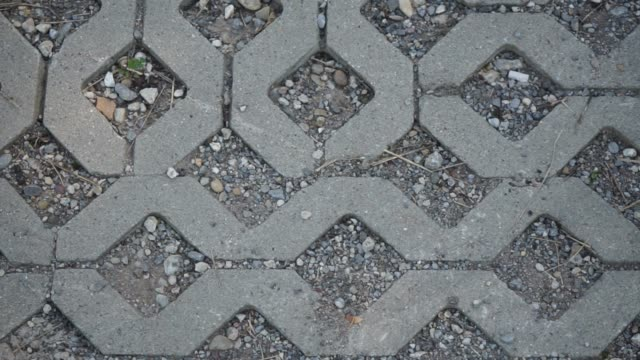 Paving stones with gravel in a parking lot