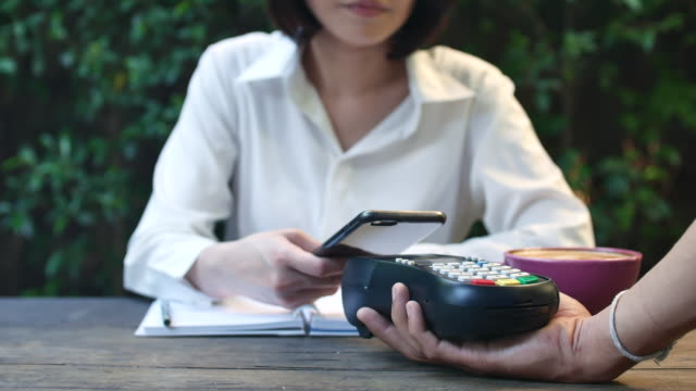 Paying Contactless payment in coffee shop video