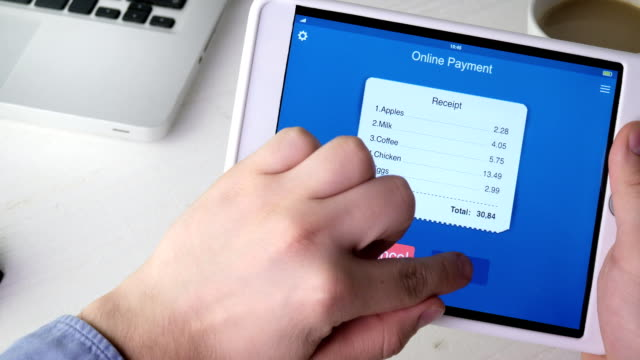 paying for bill from a grocery store using mobile application on digital tablet - online shopping filmów i materiałów b-roll